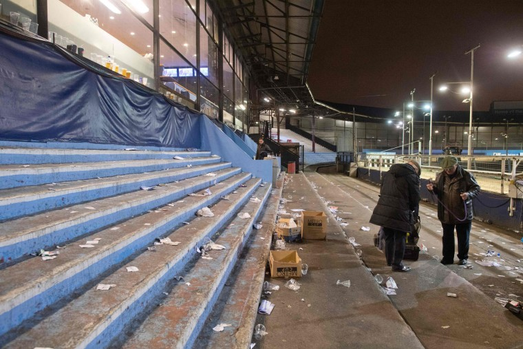 Book makers pack away their belongings after an evening of greyhound racing at the Wimbledon Stadium dog track in south London on March 18, 2017. March 25 will see the final day of racing at the Wimbledon dog track which will close to be demolished to make way for a new stadium for AFC Wimbledon. The closer of track will mark the end of the once hugely popular working-class sport of greyhound racing in London. (Justin Tallis/AFP/Getty Images)