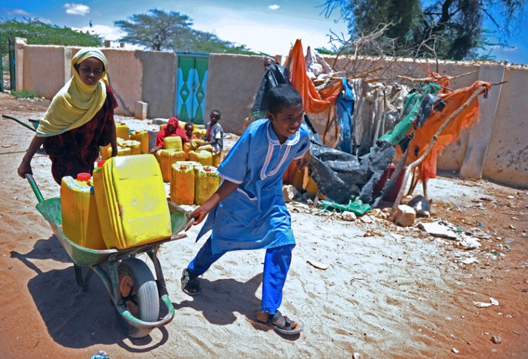 This file photo taken on May 16, 2015 shows refugee children pushing wheelbarrows loaded with Jerry cans full of drinking water from a water pump in Hargeisa, the capital of Somaliland, northwestern Somalia. Approximately one in four children worldwide will live in regions with extremely scarce water resources by 2040, UNICEF said in a report on March 22, 2017. In research released on World Water Day, the United Nations children's agency warned that in just over two decades nearly 600 million children will be living in areas with severely limited safe water sources, as population growth and surging demand for water clash with the effects of climate change. (MOHAMMED ABDIWAHAB/AFP/Getty Images)