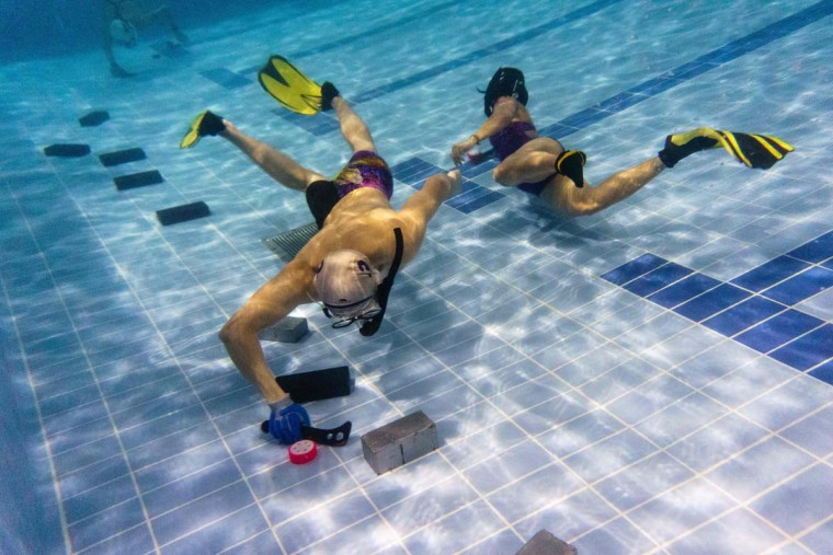 "In this photo taken on February 15, 2017, members of the ""HK Typhoon"" underwater hockey club take part in exercise drills during the team's once-a-week practice session at a 25-meter school pool in Hong Kong. The gravity defying sport of underwater hockey has gained a worldwide following -- now a Hong Kong team is diving in as the game takes off in Asia. (ANTHONY WALLACE/AFP/Getty Images)"