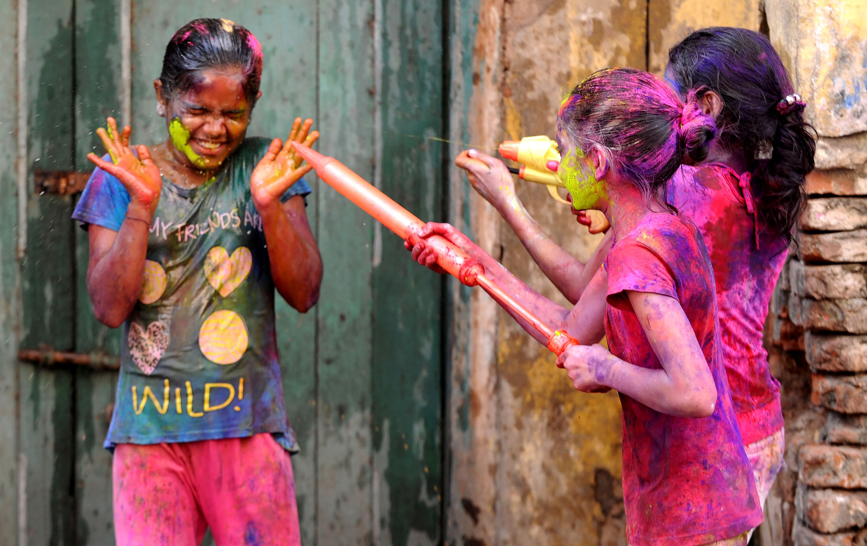 holi the festival of colours Indian hindu devotees celebrate holi, the spring festival of colours, during a traditional gathering at nandgaon village in uttar pradesh state on march 7, 2017.