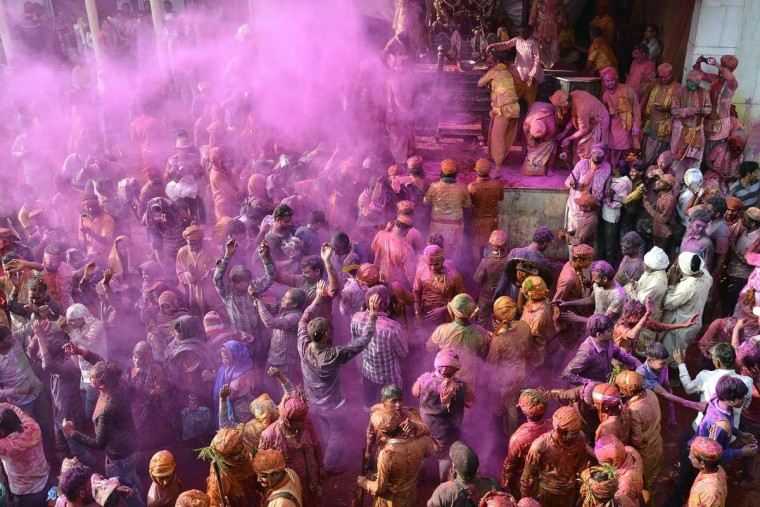 Indian Hindu devotees celebrate Holi, the spring festival of colors, during a traditional gathering at Nandgaon village in Uttar Pradesh state on March 7, 2017. Holi is observed in India at the end of the winter season on the last full moon of the lunar month, and will be celebrated on March 13 this year. (AFP/Getty Images)