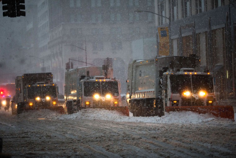 Snow plows line up on Fifth Avenue during a day of heavy snow and freezing rain on March 14, 2017 in New York City. Much of the Northeast is under a state of emergency as a blizzard is expected to bring over one foot of snow and high winds to the area. (Photo by Kevin Hagen/Getty Images)