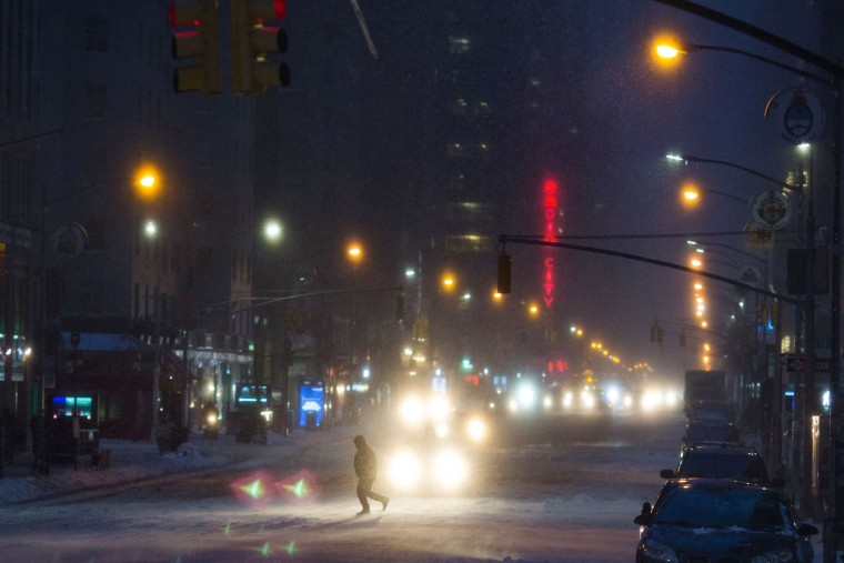 Cars move through the snow during a day of heavy snow and freezing rain on March 14, 2017 in New York City. Much of the Northeast is under a state of emergency as a blizzard is expected to bring over one foot of snow and high winds to the area. (Photo by Kevin Hagen/Getty Images)