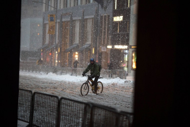 A cyclist in the snow on Fifth Avenue during a day of heavy snow and freezing rain on March 14, 2017 in New York City. Much of the Northeast is under a state of emergency as a blizzard is expected to bring over one foot of snow and high winds to the area. (Photo by Kevin Hagen/Getty Images)