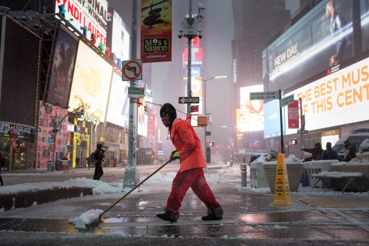 Times Square Alliance workers maintain the district during a day of heavy snow and freezing rain on March 14, 2017 in New York City. Much of the Northeast is under a state of emergency as a blizzard is expected to bring over one foot of snow and high winds to the area. (Photo by Kevin Hagen/Getty Images)