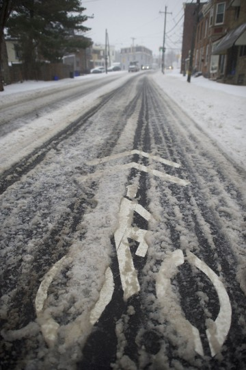 Snow lies on top of a bicycle route March 14, 2017 in Philadelphia, Pennsylvania. A blizzard is forecast to bring more than a foot of snow and high winds to up to eight states in the Northeast region, as New York and New Jersey are under a state of emergency. School districts across the entire region were closed and thousands of flights were canceled. (Photo by Mark Makela/Getty Images)