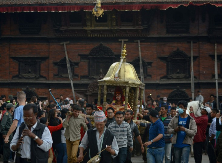Nepal's the Living Goddess, the Kumari, is carried through a crowd during the Ghode Jatra (Horse Race) Festival in Kathmandu on March 27, 2017. The Kumari is worshipped by both Hindus and Buddhists as a living goddess and a protector bringing good luck and prosperity. (Prakash Mathema/AFP/Getty Images)