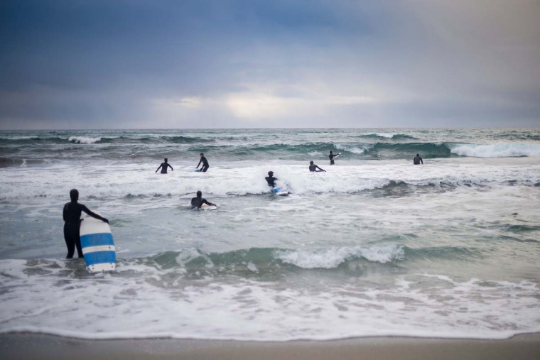 Novice surfers learn how to ride a wave in Unstad along the northern Atlantic Ocean on March 12, 2017. (OLIVIER MORIN/AFP/Getty Images)