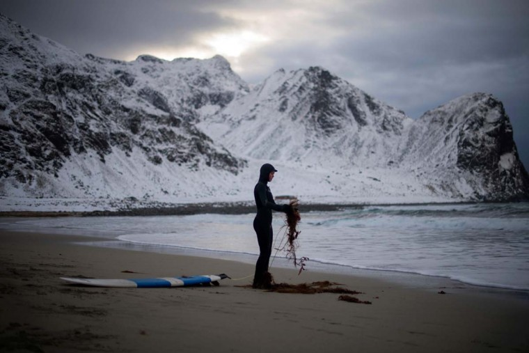 A novice surfer cleans his leash in Unstad along the northern Atlantic Ocean on March 12, 2017. (OLIVIER MORIN/AFP/Getty Images)