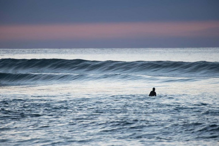 A surfer waits for a wave in Unstad along the northern Atlantic Ocean on March 12, 2017. (OLIVIER MORIN/AFP/Getty Images)