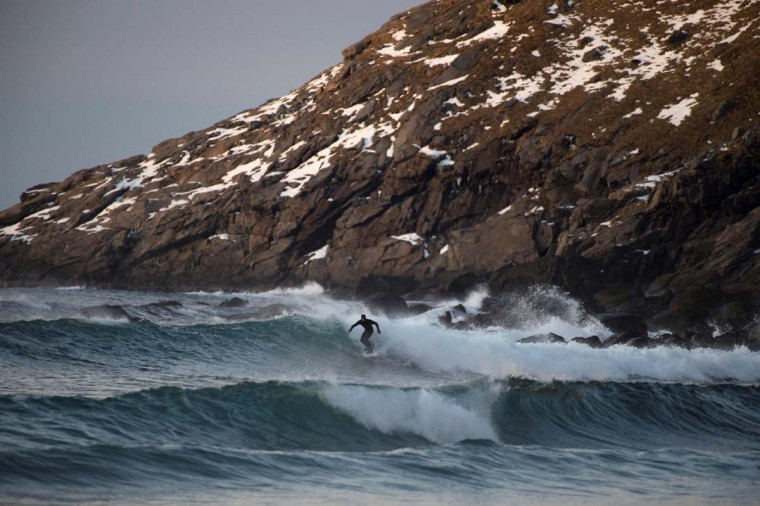 A surfer rides a wave in Unstad along the northern Atlantic Ocean on March 12, 2017. (OLIVIER MORIN/AFP/Getty Images)