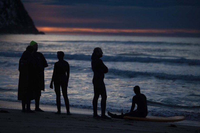 Surfers rest after an evening surfing at Unstad along the northern Atlantic Ocean on March 12, 2017. (OLIVIER MORIN/AFP/Getty Images)