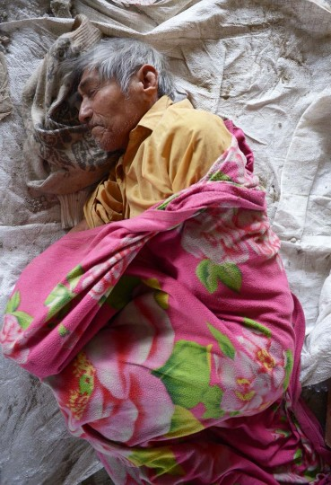 A displaced resident lies down to sleep in a makeshift shelter in Piura, northern Peru on March 28, 2017. (MIGUEL ARREATEGUI,STR/AFP/Getty Images)