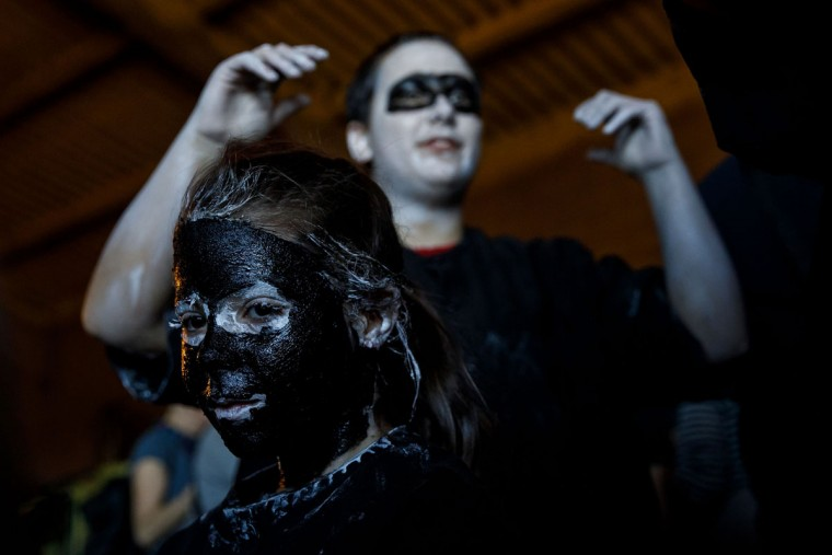 "A girl with grease smeared on her face to represent ""Diablos de Luzon"" (Luzon's devils) performs during the carnival in Luzon, near Guadalajara, on February 25, 2017.(CESAR MANSO/AFP/Getty Images)"