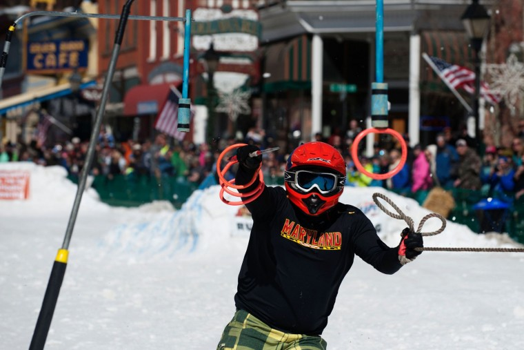 Skier Jason Decker reaches for the final ring while competing in the 68th annual Leadville Ski Joring weekend competition on Saturday, March 4, 2017 in Leadville, Colorado. Skijoring, which has its origins as a competitive sport in Scandinavia, has been adapted over the years to include a team made up of a rider and skier who must navigate jumps, slalom gates, and the spearing of rings for points. Leadville, with an elevation of 10,152 feet (3,094 m), the highest incorporated city in North America, has been hosting skijoring competitions since 1949. (Jason Connolly/AFP/Getty Images)
