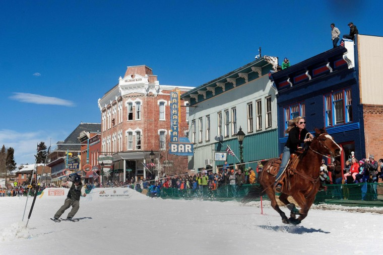 A rider races down Harrison Avenue while a skier navigates the course during the 68th annual Leadville Ski Joring weekend competition on Saturday, March 4, 2017 in Leadville, Colorado. Skijoring, which has its origins as a competitive sport in Scandinavia, has been adapted over the years to include a team made up of a rider and skier who must navigate jumps, slalom gates, and the spearing of rings for points. Leadville, with an elevation of 10,152 feet (3,094 m), the highest incorporated city in North America, has been hosting skijoring competitions since 1949. (Jason Connolly/AFP/Getty Images)