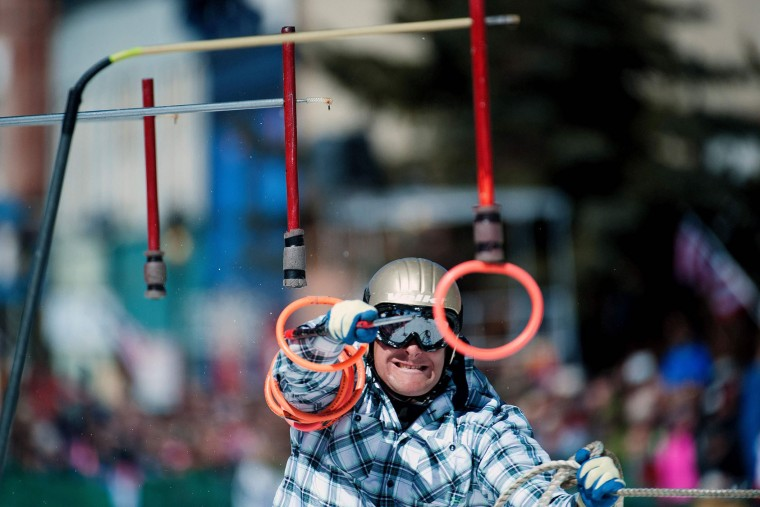 Skier Greg Dahl reaches for the final ring while competing in the 68th annual Leadville Ski Joring weekend competition on Saturday, March 4, 2017 in Leadville, Colorado. Skijoring, which has its origins as a competitive sport in Scandinavia, has been adapted over the years to include a team made up of a rider and skier who must navigate jumps, slalom gates, and the spearing of rings for points. Leadville, with an elevation of 10,152 feet (3,094 m), the highest incorporated city in North America, has been hosting skijoring competitions since 1949. (Jason Connolly/AFP/Getty Images)