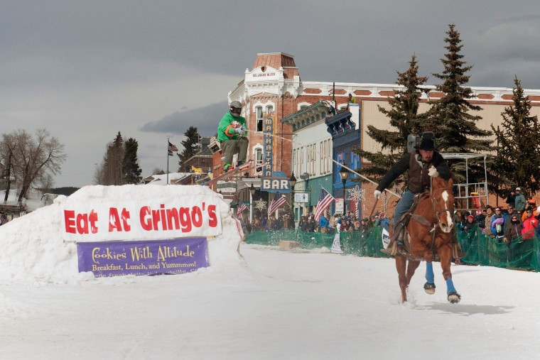Rider Will James races down Harrison Avenue as skier Sean Gerber airs out off the first jump of the Leadville skijoring course during the 68th annual Leadville Ski Joring weekend competition on March 5, 2017 in Leadville, Colorado. Skijoring, which has its origins as a competitive sport in Scandinavia, has been adapted over the years to include a team made up of a rider and skier who must navigate jumps, slalom gates, and the spearing of rings for points. Leadville, with an elevation of 10,152 feet (3,094 m), the highest incorporated city in North America, has been hosting skijoring competitions since 1949. (Jason Connolly/AFP/Getty Images)