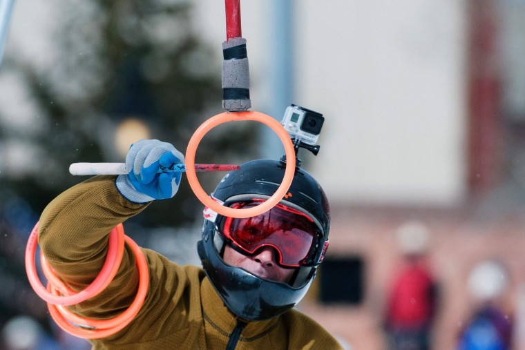 Skier Bruce Stott reaches for the final ring while competing in the 68th annual Leadville Ski Joring weekend competition on March 5, 2017 in Leadville, Colorado. Stott who was teamed up with 17-year-old rider Savannah McCarthy, finished in first place in the challenging Open Division. Skijoring, which has its origins as a competitive sport in Scandinavia, has been adapted over the years to include a team made up of a rider and skier who must navigate jumps, slalom gates, and the spearing of rings for points. Leadville, with an elevation of 10,152 feet (3,094 m), the highest incorporated city in North America, has been hosting skijoring competitions since 1949. (Jason Connolly/AFP/Getty Images)