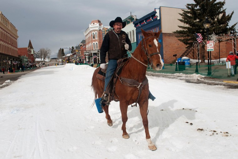 Will James of Penrose, Colorado rides his horse Red down Harrison Avenue in Leadville, Colorado after the finish of the 68th annual Leadville Ski Joring weekend competition on March 5, 2017 in Leadville, Colorado. Skijoring, which has its origins as a competitive sport in Scandinavia, has been adapted over the years to include a team made up of a rider and skier who must navigate jumps, slalom gates, and the spearing of rings for points. Leadville, with an elevation of 10,152 feet (3,094 m), the highest incorporated city in North America, has been hosting skijoring competitions since 1949. (Jason Connolly/AFP/Getty Images)