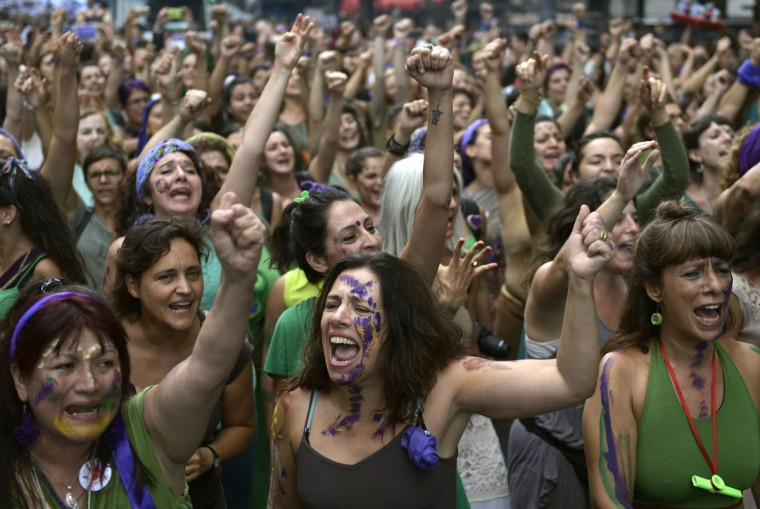 "Women chant slogans during the ""Ni Una Menos"" march for International Women's Day, outside the Argentine Congress in Buenos Aires on March 8, 2017. (JUAN MABROMATA/AFP/Getty Images)"