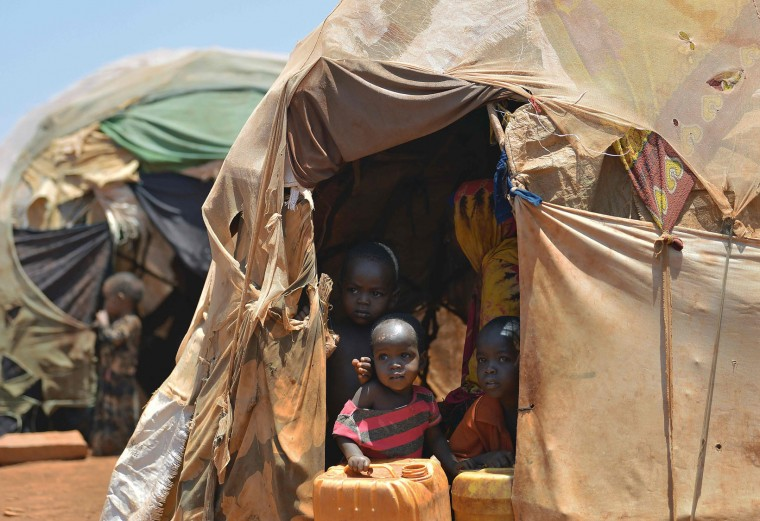 Internally displaced children appear at the entrance of a hut on March 14, 2017 at a makeshift camp on the outskirts of Baidoa, in the southwestern Bay region of Somalia, where thousands of people arrive daily after they fled the parched countryside. The United Nations is warning of an unprecedented global crisis with famine already gripping parts of South Sudan and looming over Nigeria, Yemen and Somalia, threatening the lives of 20 million people. For Somalis, the memory of the 2011 famine which left a quarter of a million people dead is still fresh. (Tony Karumba/AFP/Getty Images)
