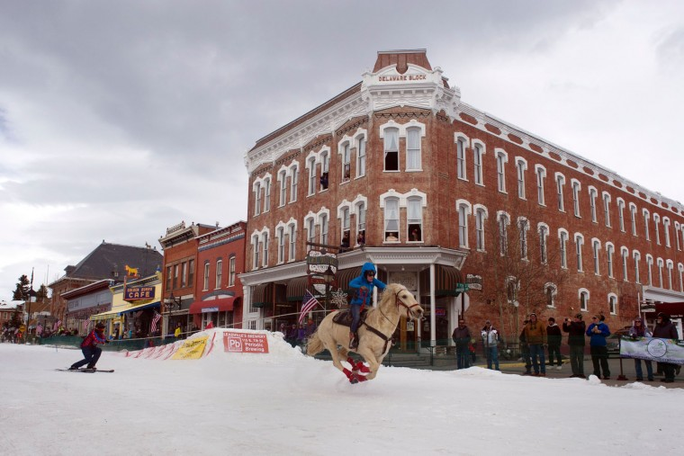 A rider races down Harrison Avenue while a skier navigates the course during the 68th annual Leadville Ski Joring weekend competition on March 5, 2017 in Leadville, Colorado. Skijoring, which has its origins as a competitive sport in Scandinavia, has been adapted over the years to include a team made up of a rider and skier who must navigate jumps, slalom gates, and the spearing of rings for points. Leadville, with an elevation of 10,152 feet (3,094 m), the highest incorporated city in North America, has been hosting skijoring competitions since 1949. (Jason Connolly/AFP/Getty Images)