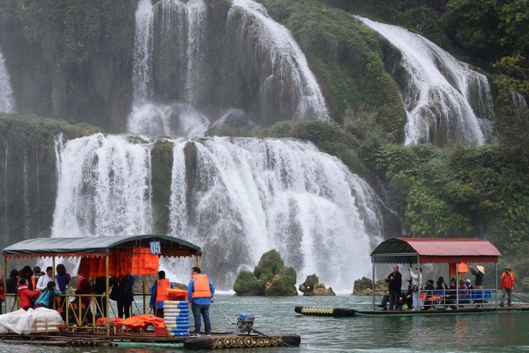 This picture taken on March 12, 2017 shows Vietnamese (right) and Chinese (left) tourist rafts on the waters in front of the Thac Ban Gioc or Ban Gioc falls, located on the Vietnam-China land border area in Trung Khanh district, Vietnam's northern province of Cao Bang. (HOANG DINH NAM/AFP/Getty Images)
