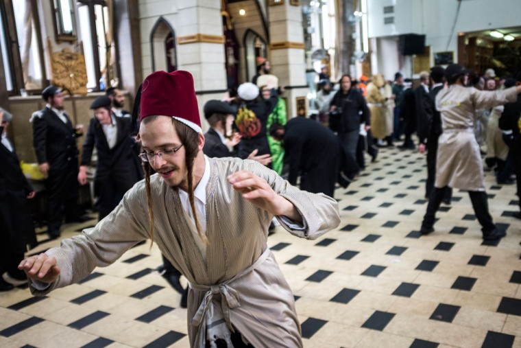 JERUSALEM, ISRAEL - MARCH 13: Ultra Orthodox Jews celebrating holiday of Purim on March 13, 2017 in Jerusalem, Israel. The carnival-like Purim holiday is celebrated with parades and costume parties to commemorate the deliverance of the Jewish people from a plot to exterminate them in the ancient Persian empire 2,500 years ago, as described in the Book of Esther. (Photo by Ilia Yefimovich/Getty Images)