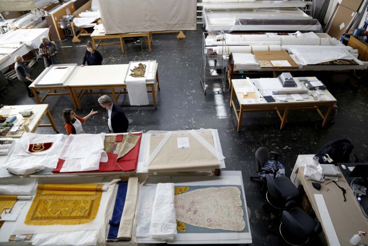 "Conservation projects are in progress in the Textile Conservation Laboratory at the Cathedral of St. John the Divine in New York, Wednesday, March 22, 2017. Experts at the cathedral just spent 16 years sprucing up its super-size wall hangings with a labor-intensive process that uses dental probes, tweezers and other tools. Now the historic house of worship is inviting the public to enjoy the fruits of its labors. An exhibit called ""The Barberini Tapestries, Scenes from the Life of Christ"" runs through June 25. (AP Photo/Seth Wenig)"