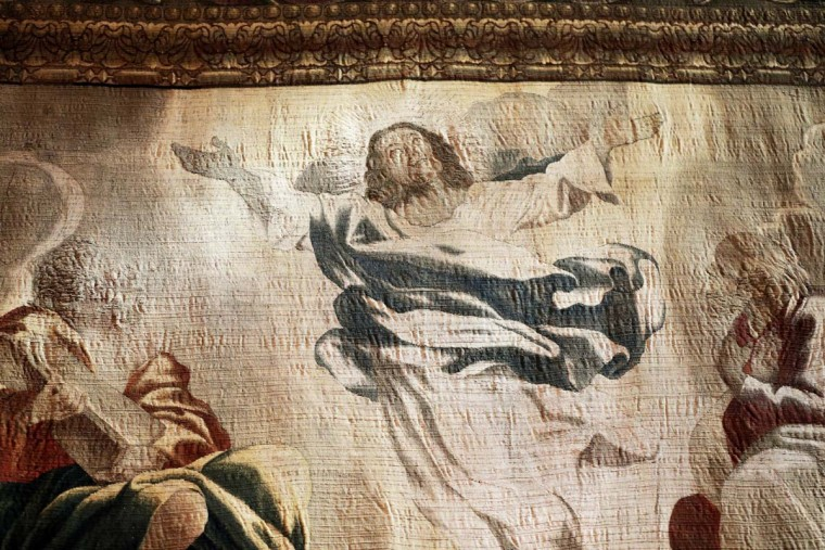 """Recently preserved tapestries are displayed in an exhibit at the Cathedral of St. John the Divine in New York, Wednesday, March 22, 2017. Experts at the cathedral just spent 16 years sprucing up its super-size wall hangings with a labor-intensive process that uses dental probes, tweezers and other tools. Now the historic house of worship is inviting the public to enjoy the fruits of its labors. An exhibit called """"The Barberini Tapestries, Scenes from the Life of Christ"""" runs through June 25. (AP Photo/Seth Wenig)"""