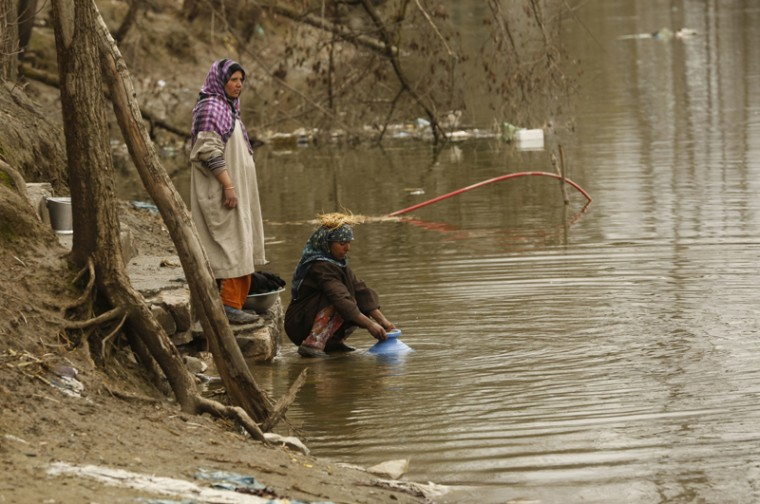Kashmiri village women collect water from a river, on World Water Day in Dasilpora, north of Srinagar, Indian-controlled Kashmir, Wednesday, March 22, 2017. (Mukhtar Khan/AP)