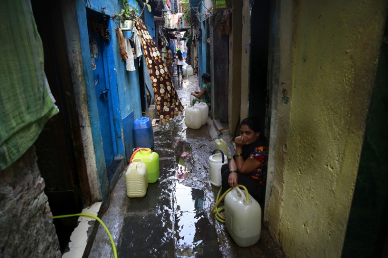 Indian women collect water from a shared tap at a slum in Mumbai, India, Wednesday, March 22, 2017. India has the world's highest number of people without access to clean water. According to UNICEF, the U.N.'s children's agency, nearly 78 million Indians — or about 5 percent of the country's 1.3 billion population — must make do with contaminated water sources or buy water at high rates. (Rafiq Maqbool/AP)
