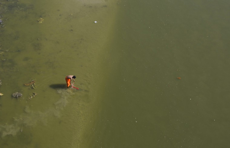 An Indian man washes his clothes in the Ganges River on World Water Day in Allahabad, India, Wednesday, March 22, 2017. Two of India's most iconic rivers, the Ganges and the Yamuna, considered sacred by nearly a billion Hindus in the country, have been given the status of living entities to save them from further harm caused by widespread pollution. (Rajesh Kumar Singh/AP)