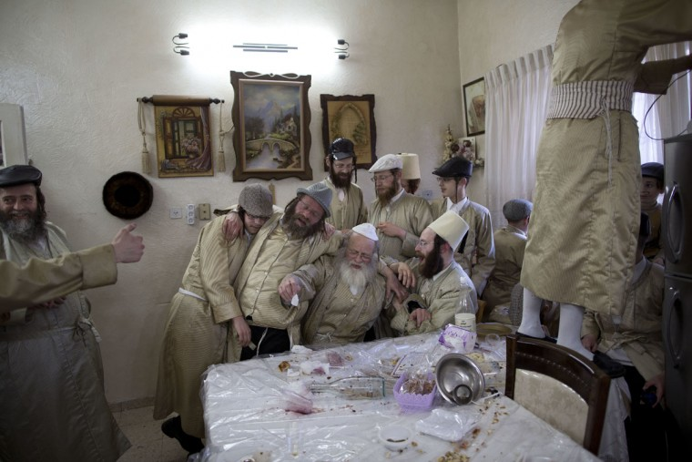 Ultra-Orthodox Jewish men celebrate during the Jewish holiday of Purim in Mea Shearim ultra-Orthodox neighborhood in Jerusalem, Monday, March 13, 2017. The Jewish holiday of Purim celebrates the Jews' salvation from genocide in ancient Persia, as recounted in the Scroll of Esther. (AP Photo/Oded Balilty)