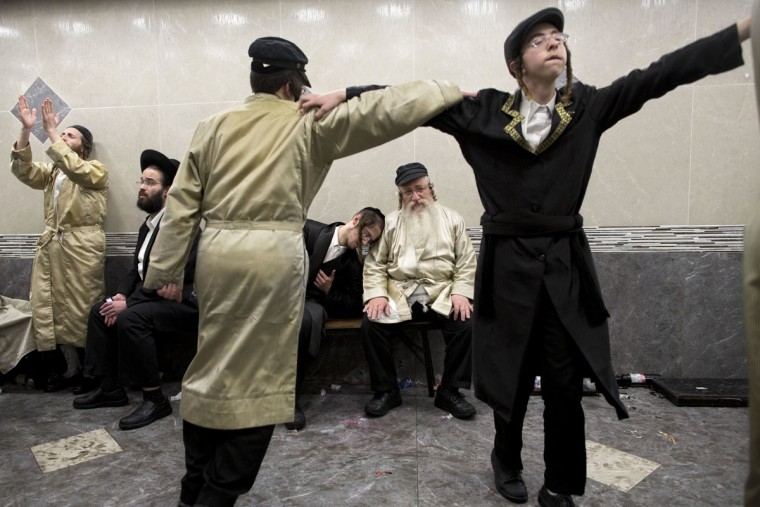 Ultra-Orthodox Jewish men celebrate after getting drunk during the Jewish holiday of Purim in Mea Shearim ultra-Orthodox neighborhood in Jerusalem, Monday, March 13, 2017. The Jewish holiday of Purim celebrates the Jews' salvation from genocide in ancient Persia, as recounted in the Scroll of Esther. (AP Photo/Oded Balilty)