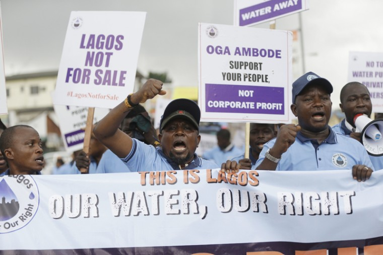 People protest against controversial water bills by government in Lagos, Nigeria Wednesday, March 22, 2017. Environmental rights group Friends of the Earth staged a World water day protest Wednesday, over controversial Lagos State environmental bill that criminalizes individuals sourcing water from natural sources. (Sunday Alamba/AP)