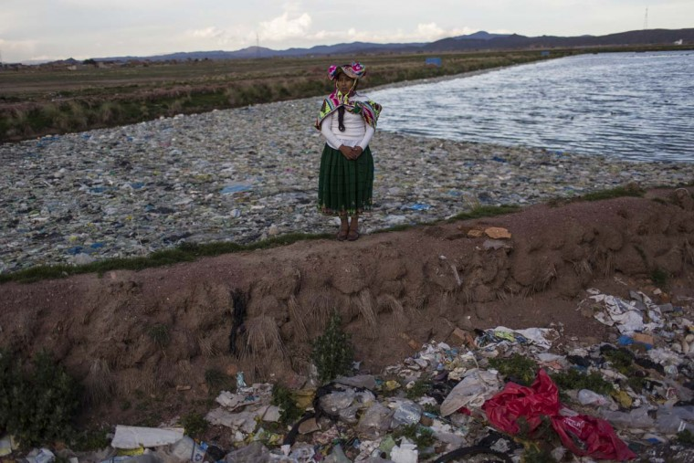 "In this Feb. 1, 2017 photo, environmental activist Maruja Inquilla poses for a photo next to a Municipal waste treatment plant with water that flows into Lake Titicaca, in Juliaca, in the Puno region of Peru. ""If the frogs could talk they would say, 'This is killing me,'"" said Inquilla, who recently showed up at the Puno governor's house carrying plastic bags filled with hundreds of dead frogs in protest. (AP Photo/Rodrigo Abd)"