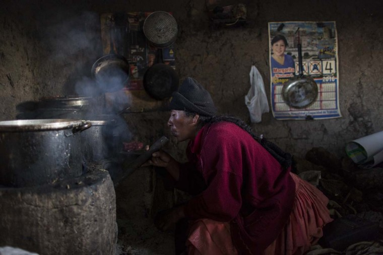 "In this Feb. 4, 2017 photo, Lilian Avila Diaz lights her firewood stove to cook lunch for her family in Coata, a small village on the shore of Lake Titicaca, in the Puno region of Peru. The amount of mercury consumed by Titicaca residents is ""unacceptable,"" according to Dr. Jane M. Hightower, who specializes in internal medicine at the California Pacific Medical Center in San Francisco and author of the book ""Diagnosis: Mercury: Money, Politics & Poison,"" after reviewing a 2014 study on fish caught from Lake Titicaca. (AP Photo/Rodrigo Abd)"