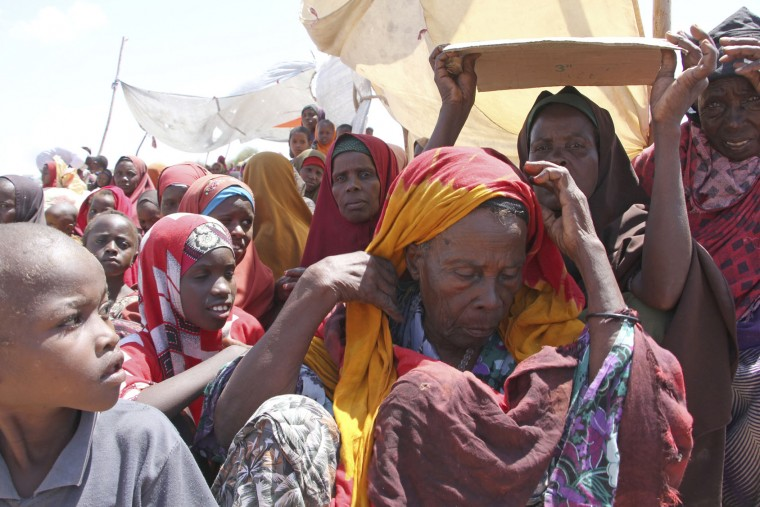 Newly displaced Somali women and children gather, just outside of Mogadishu, in Somalia, Monday, March, 27, 2017. Somalia's drought is threatening 3 million lives, according to the U.N. In recent months, aid agencies have been scaling up their efforts but they say said more support is urgently needed to prevent the crisis from worsening. (AP Photo/Farah Abdi Warsameh)