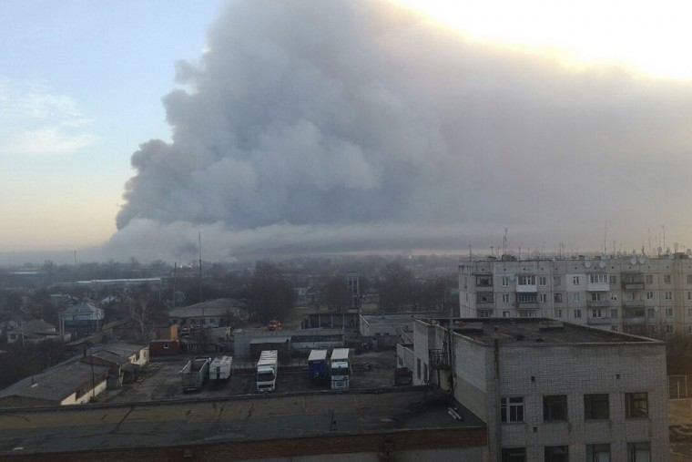 This photo provided by Ukrainian Emergency Situations Ministry press service a fire rages at a military ammunition depot in Balaklia near Khrakiv in Ukraine on Thursday, March 23 2017. There was no immediate information about any casualties. Ukrainian officials say the massive fire was caused by sabotage and prompted the evacuation of some 20,000 people. (AP Photo/Ministry of Emergency Situations press service via AP)
