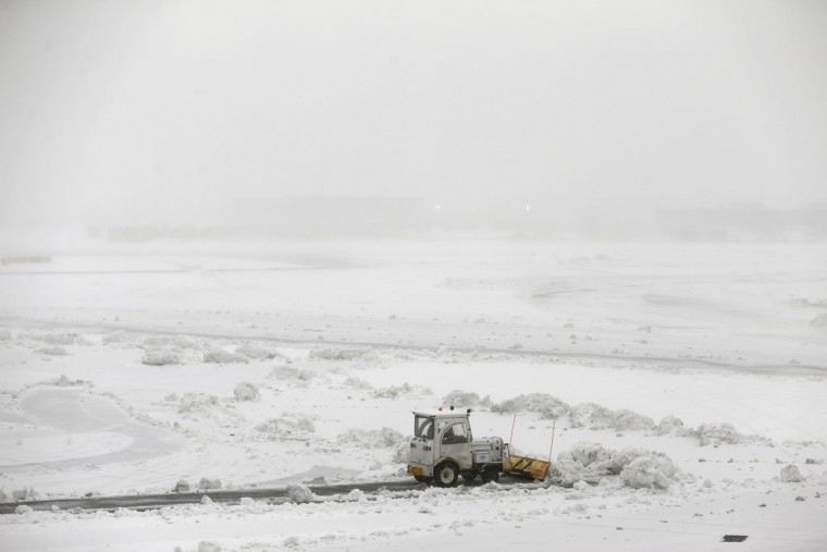 Snow plows work to keep the grounds clear at Newark Liberty International Airport in Newark, N.J., Tuesday, March 14, 2017. A storm pounded the Northeast with more than a foot of snow in places Tuesday, paralyzing much of the Washington-to-Boston corridor after a remarkably mild February had lulled people into thinking the worst of winter was over. (AP Photo/Seth Wenig)