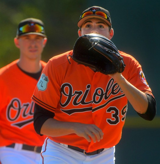 Baltimore Orioles starting pitcher Kevin Gausman fields during spring training at the Ed Smith Stadium baseball complex. (Karl Merton Ferron / Baltimore Sun)