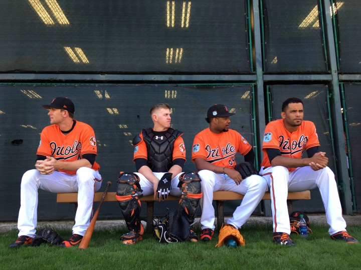 From left, Baltimore Orioles pitcher Joe Gunkel (left) sits outside the batting cage with catchers Chance Sisco, Jayson Aquino and pitcher Richard Rodr'guez, waiting their turns to participate in bullpen sessions during spring training at the Ed Smith Stadium baseball complex. (Karl Merton Ferron / Baltimore Sun)