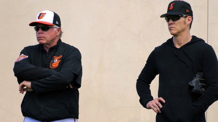 Baltimore Orioles manager Buck Showalter (white cap) talks with Brady Anderson, Vice President of Baseball Operations during spring training at the Ed Smith Stadium baseball complex. (Karl Merton Ferron / Baltimore Sun)