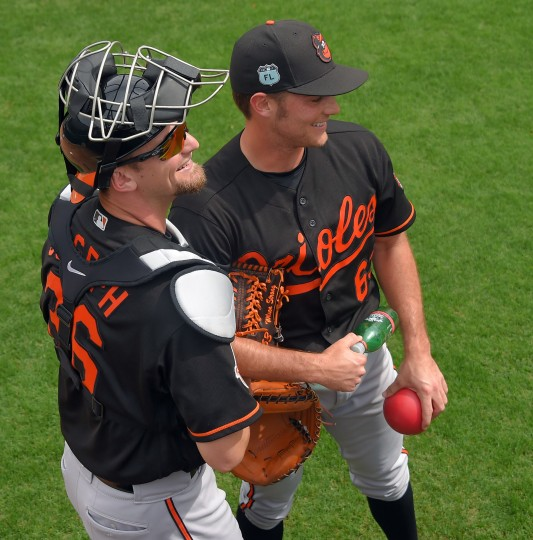 Baltimore Orioles catcher Caleb Joseph (left) and pitcher Tyler Wilson stand in the bullpen during the team's first intersquad game at Ed Smith Stadium baseball complex. (Karl Merton Ferron / Baltimore Sun)