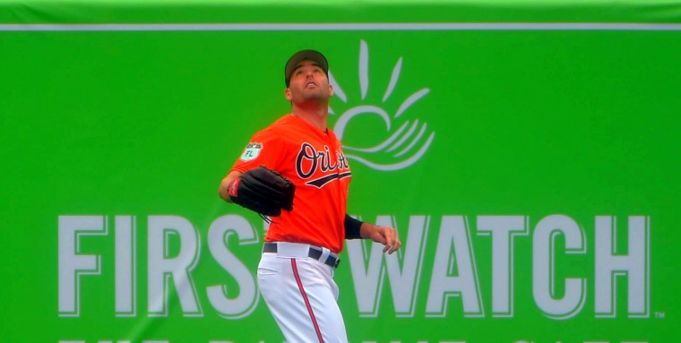 Baltimore Orioles right fielder Seth Smith ranges back in the second intersquad game of spring training at Ed Smith Stadium. (Karl Merton Ferron / Baltimore Sun)