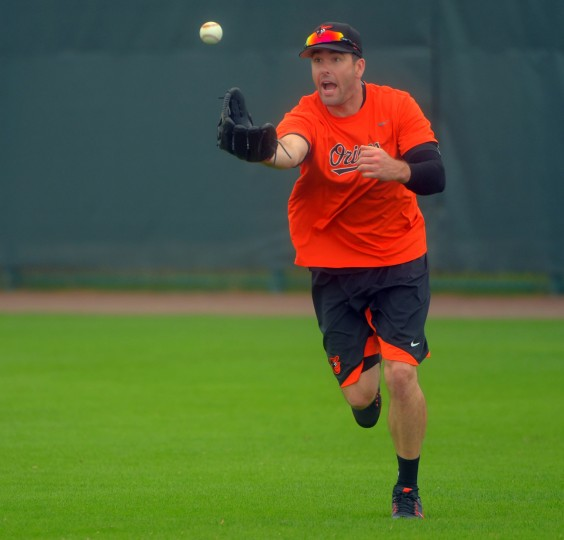 Baltimore Orioles right fielder Seth Smith reacts as the ball he fields pops out of his glove for a moment, while participating in fielding drills before the second intersquad game of spring training at the Ed Smith Stadium baseball complex. (Karl Merton Ferron / Baltimore Sun)