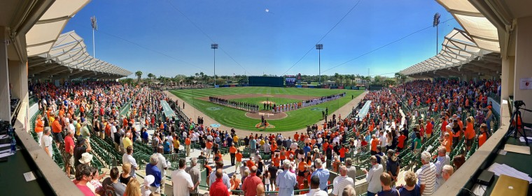 Fans stand with the Pittsburgh Pirates and Baltimore Orioles during the National Anthem at the Orioles' inaugural spring training home opener at Ed Smith Stadium. Baltimore bounced back to beat Pittsburgh, 8-3. (Karl Merton Ferron / Baltimore Sun)