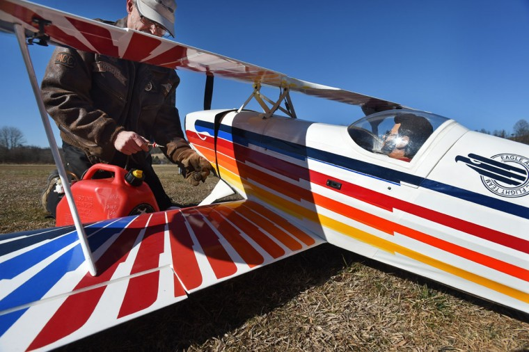 Arthur Pearce, of Bel Air, put fuel into his Christen Eagle model airplane. (Kenneth K. Lam/Baltimore Sun)